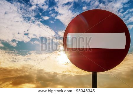 Road Sign Do Not Enter Against The Evening Sky Sunset
