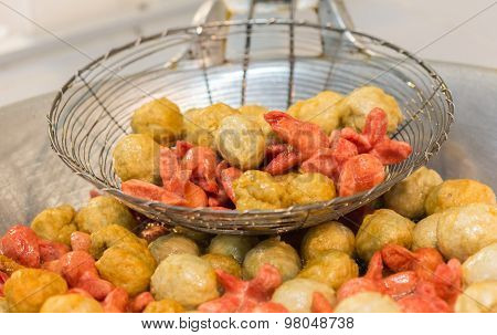 Cooking, Asian Kitchen And Food Concept - Close Up Of Cook Frying Meat Or Rice Balls In Oil At Stree