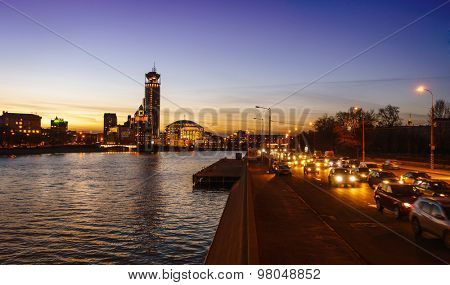 Nighttime image of the Moscow River and Swissotel building