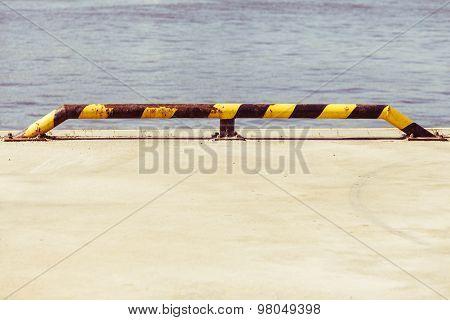 Black And Yellow Strip Balustrade At Port Promenade