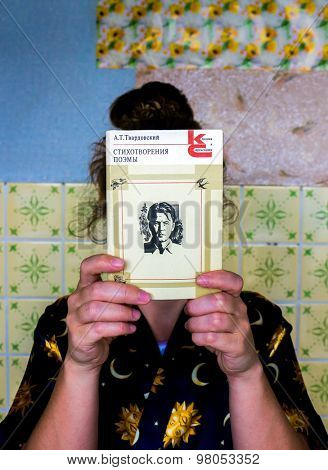 GOMEL, BELARUS - AUGUST 2, 2015: Girl holding a book by Alexander Tvardovsky