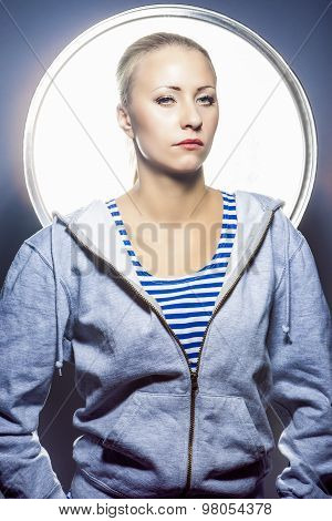 Fashion Concepts. Portrait Of Thoughtful Blond Caucasian Female In Hoody Jacket Standing In Studio E