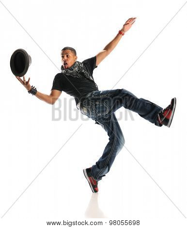 Young African American hip hop dancer performing with hat isolated over white background