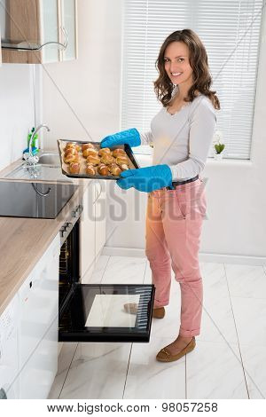 Woman Holding Baking Tray With Bread