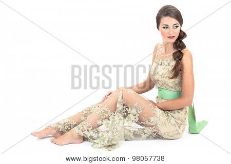 girl in a beautiful dress on a white background