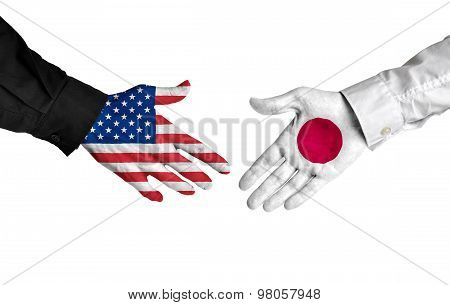 American and Japanese leaders shaking hands on a deal agreement