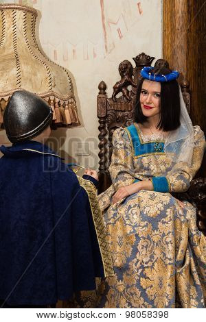 Mother and son in medieval costumes, in a beautiful interior. Costume photo session.