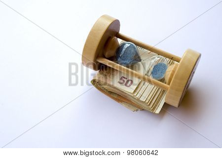 Concept or conceptual euro paper money banknote with a sand glass or time background