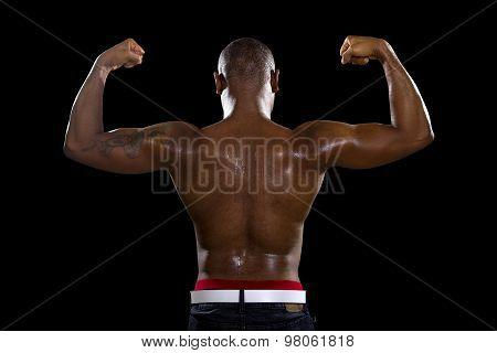 Fit Black Man Flexing Back Muscles