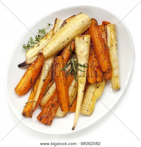 Roasted parsnips and carrots garnished with rosemary and thyme.  White plate, overhead view.
