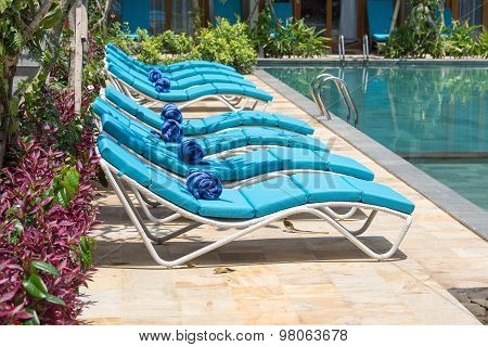 Relaxing Beach Chairs And Swimming Pool