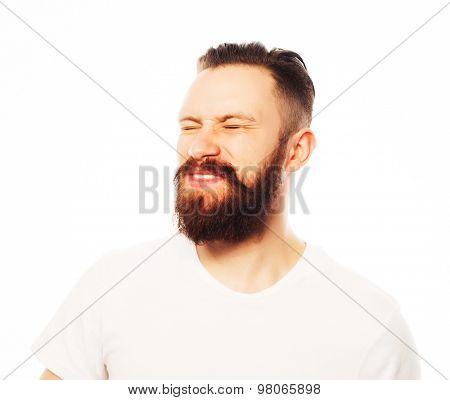 Stylish bearded man in white shirt. Close up portrait over white background.