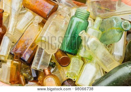 Heap Of Old Dirty Bottles For Sale At The Bazaar As Background
