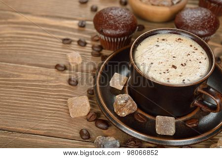 Cup Of Coffee And Chocolate Muffins