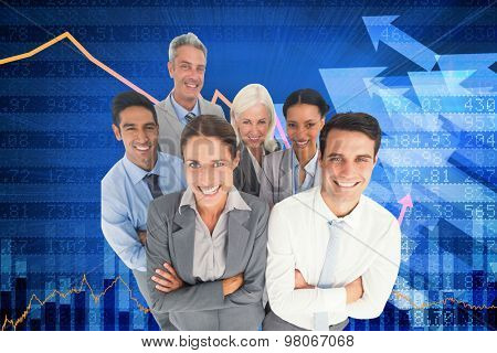 Smiling business people looking at camera with arms crossed against stocks and shares