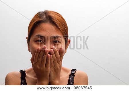 Beautiful  Young Woman Covering The Face With Her Hand. Isolated On White Background