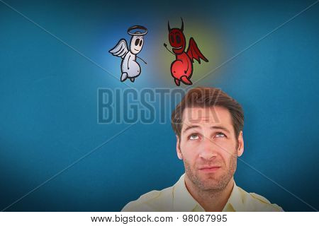 Handsome young man looking confused against blue background