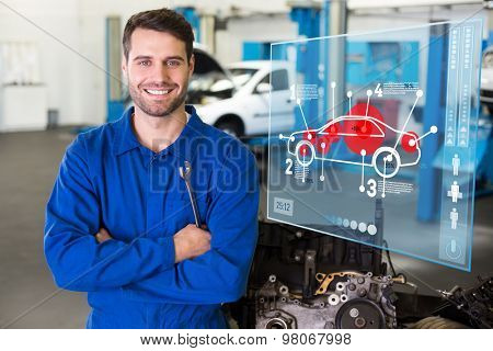 Car interface against mechanic smiling at the camera
