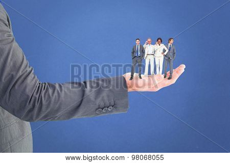 Business team against blue background