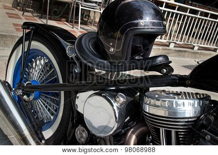 Black Vintage Style Motorcycle With Chrome And Black Helmet