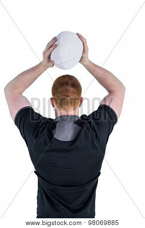 Rear view of a rugby player about to throw a rugby ball