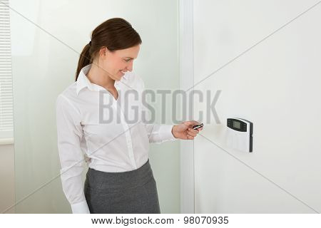 Businesswoman Operating Door Security System