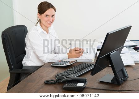 Accountant Doing Calculation At Desk