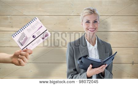 Businesswoman with diary against bleached wooden planks background