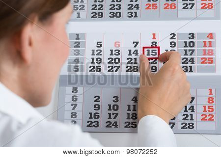 Businessperson Marking On Calendar