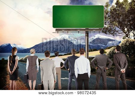Business team against billboard on a road