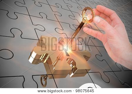 Businessman in suit holding his hand out against key unlocking jigsaw