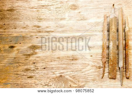 Various Different Steel Retro Rusty Rasp File Tool Collection Isolated On Wooden Background. Copy Sp