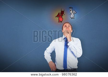 Thinking businessman touching his chin against blue background