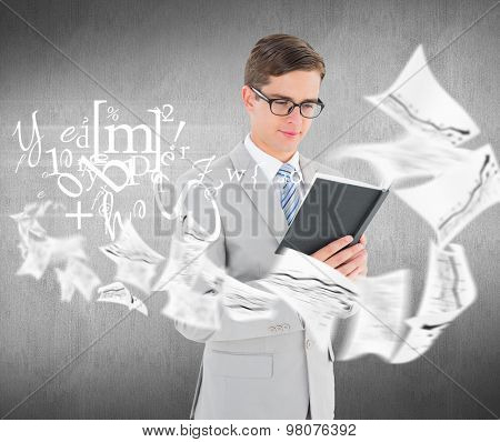 Geeky businessman reading black book against white and grey background