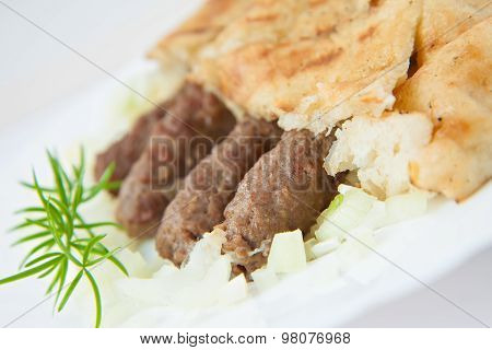 traditional bosnian food cevapi with flat bread and onion