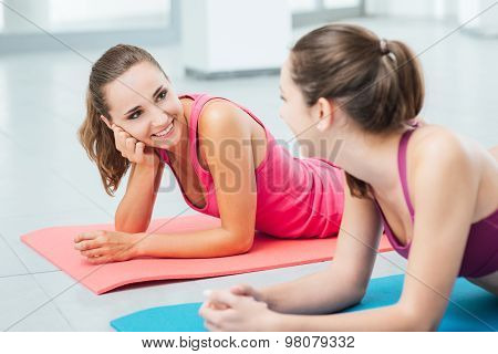 Cute Girls Chatting At The Gym