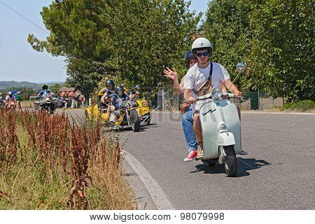 Couple Riding Vintage Scooter Vespa