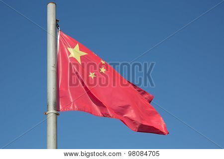Chinese National Flag Against Blue Sky