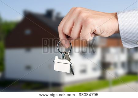 Man Hand Holding Keys With To New House