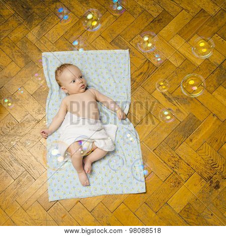 Newborn baby and bubbles