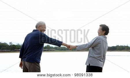 Asian Senior Couple Holding Hand