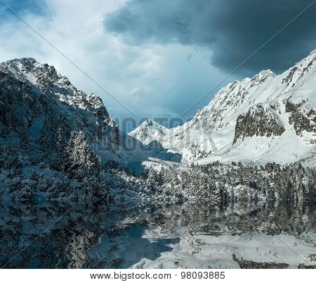 Beautiful mountains view with reflex at winter under sky.