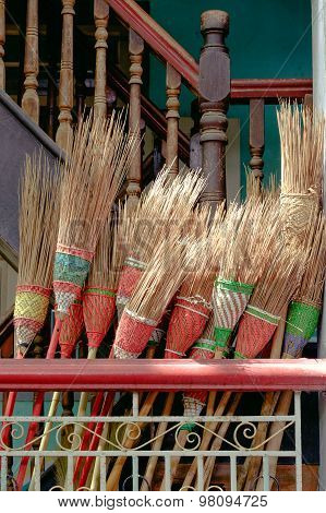 Detail Of Colorful Rustic Brooms In Wooden Stairway