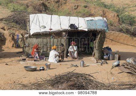 Poor Indian Family It Is Located Near The Huts In The Desert. Pushkar, India