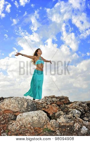 Silhouette Of Young Attractive Woman With Opened Arms Outdoors I