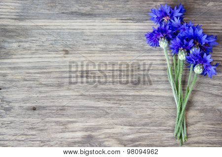 Cornflowers On The Old Wooden Table, Rustic With Copy Space