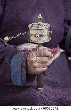 Old Tibetan Man Holding Buddhist Prayer Wheel, Ladakh, India