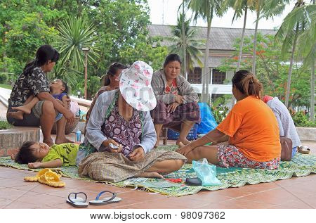 people are resting on the street in center of Luang Prabang