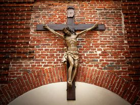 stock photo of crucifixion  - Crucifixion of Christ in the old red brick masonry - JPG