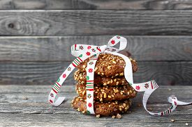 stock photo of oats  - Chocolate cookies tied with christmas ribbon - JPG